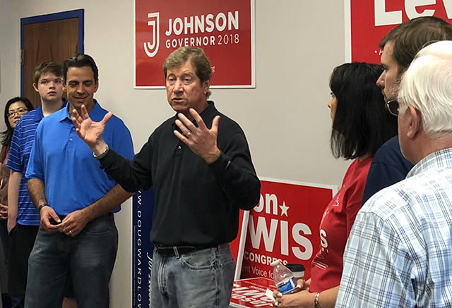 Rep. Jason Lewis speaking with campaign staffers