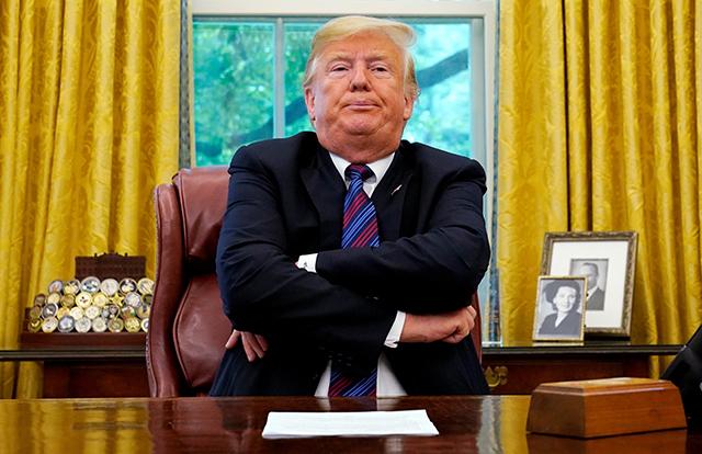 photo of donald trump at desk