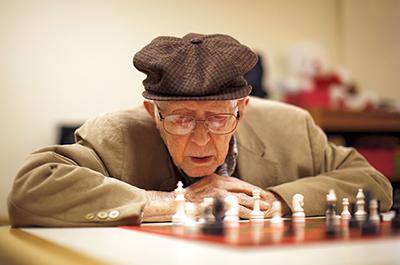 Older man playing chess