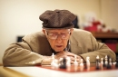 Older man playing chess