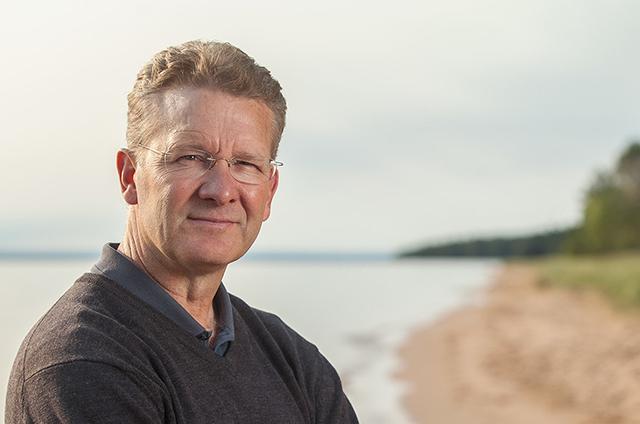 Photo of book author on beach
