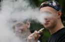 photo of man smoking e cigarette
