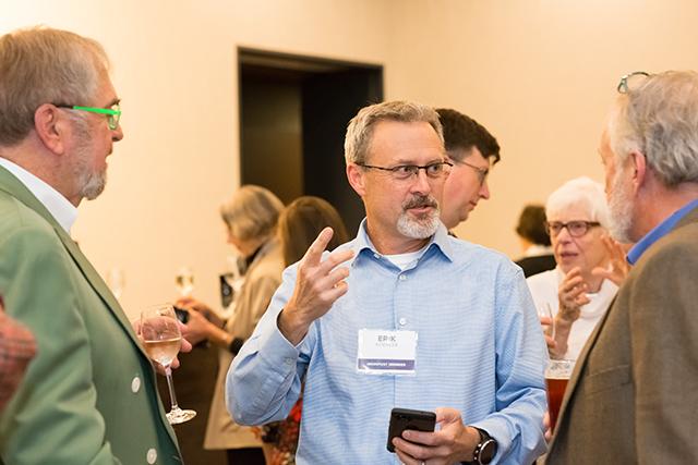 Erik Koehler flanked by Lee Lynch and MinnPost environmental columnist Ron Meador