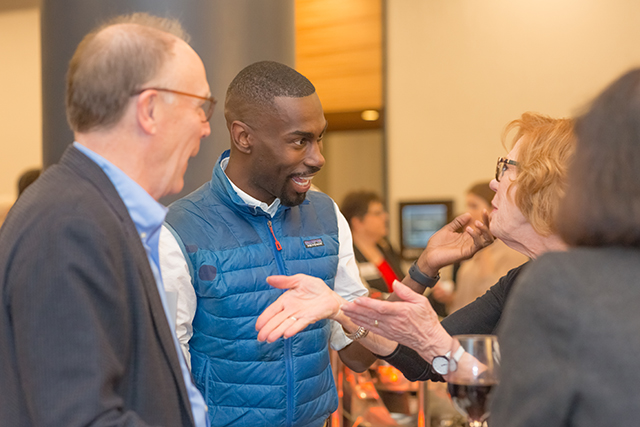 DeRay Mckesson chatting with Paul and Barbara Klaas