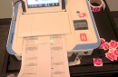 ballot feeding into the machine