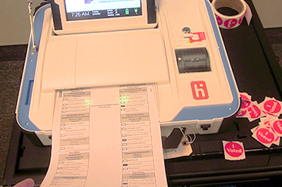 ballot feeding into the machine