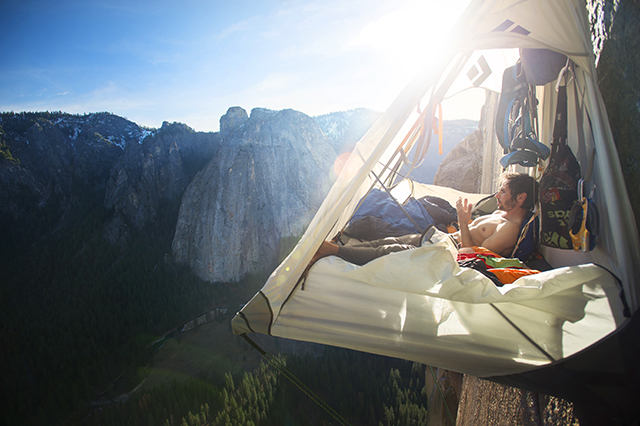 "Kevin Jorgeson resting in a portaledge from ""The Dawn Wall."""