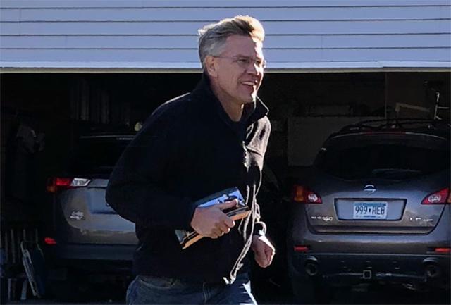 Rep. Erik Paulsen door-knocking on a recent Saturday afternoon.