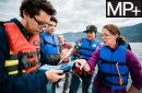 High school students collecting water samples on Flathead Lake