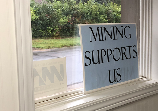A sign promoting mining in a window at Lind Industrial Supply.