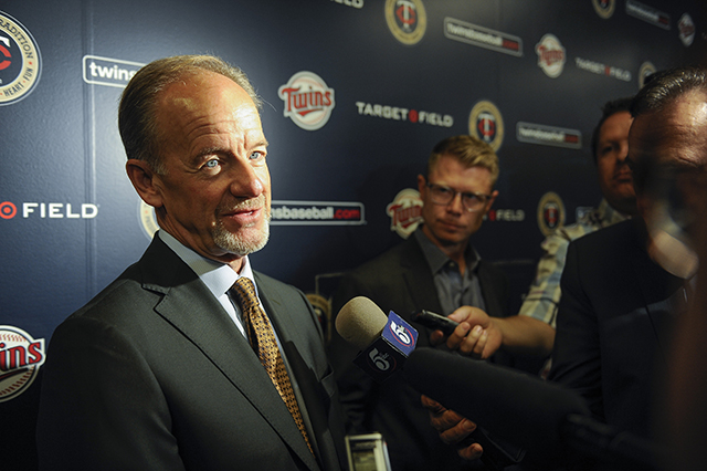 photo of jim pohlad speaking to reporters