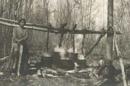 historic photo of woman boiling maple sugar on open fire