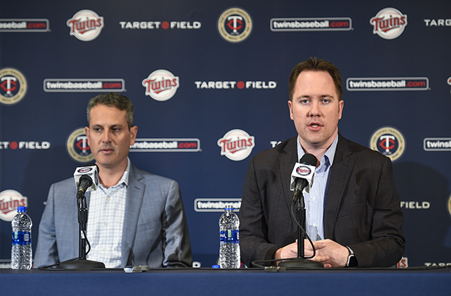 photo of thad levine and derek falvey speaking at a press conference