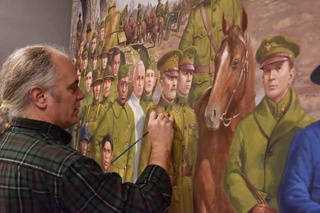 """David Geister working on """"The War"""" at the Minnesota History Center in 2016-17."""