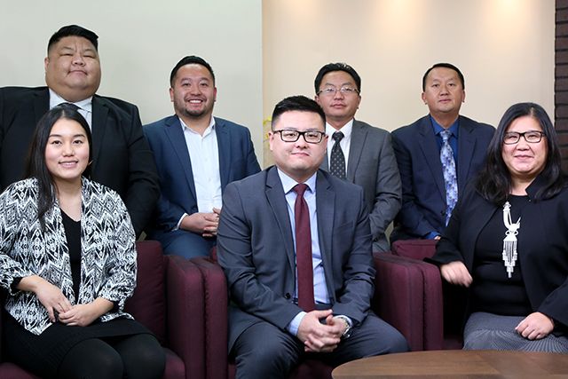 From left to right: Rep.-elect Samantha Vang, Rep.-elect Jay Xiong, Rep.-elect Fue Lee, Rep.-elect Tou Xiong, Judge-elects P. Paul Yang and Adam Yang, and Rep.-elect Kaohly Her.