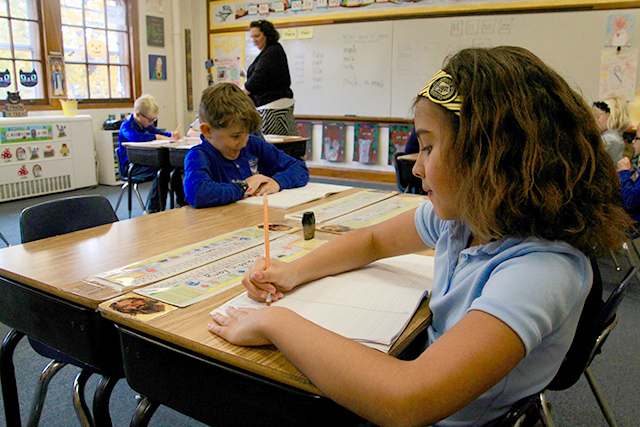 Second graders doing a phonics-based literacy activitiy in Susie Hiemenz's classroom at Holy Spirit Catholic School in St. Paul.