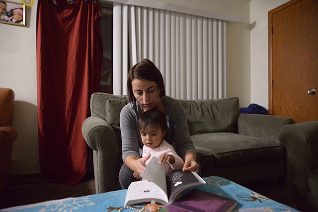 photo of woman reading book with toddler