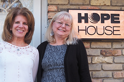 photo of front of hope house with hope house funder and program manager
