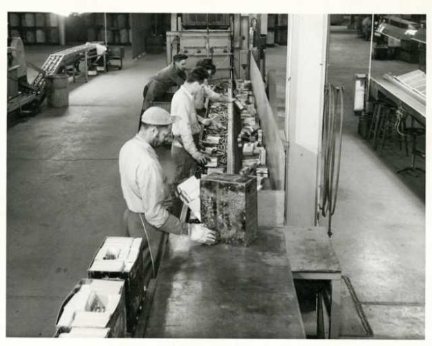 historic photo of workers in ammunition plant