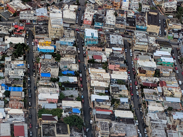 """Adnan Ahmed: """"As our plane descended in San Juan, I was struck by the sight of the blue FEMA roofs covering houses ravaged by Hurricane Maria."""""""