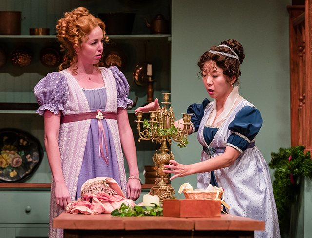 """Kelsey Didion as Mrs. Lydia Wickham and Angela Timberman as Mrs. Reynolds in a scene from """"The Wickhams."""""""