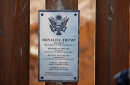 A plaque mounted to President Donald Trump's border wall