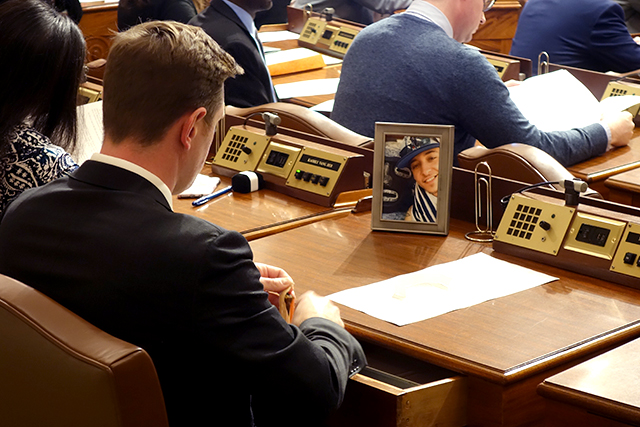 Newly elected DFL state Rep. Michael Howard keeps a photo of Alec Smith on his desk.
