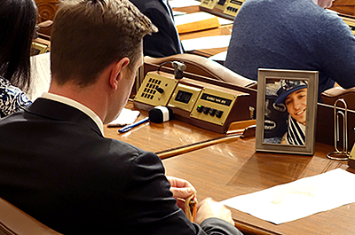 DFL state Rep. Michael Howard keeps a photo of Alec Smith on his desk