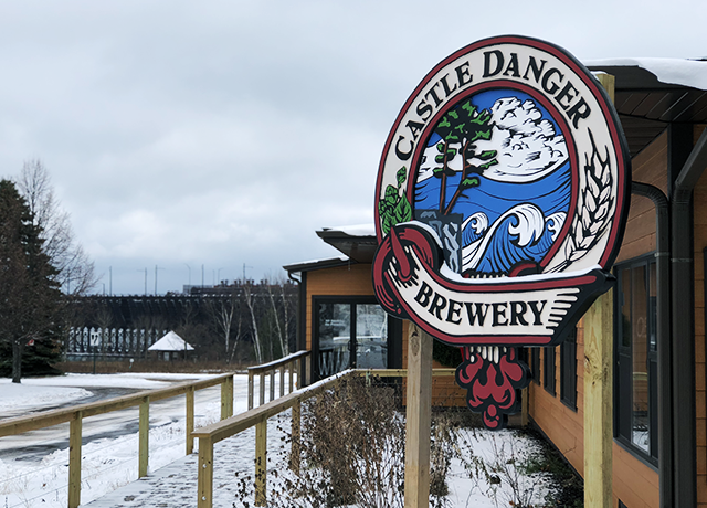 Castle Danger Brewery in Two Harbors, with the massive ore docks of Agate Bay in the background.