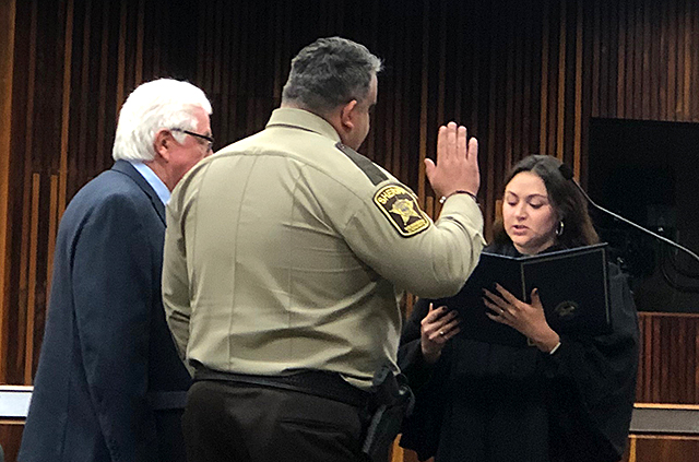 Dave Hutchinson taking the sheriff's oath of office at the Government Center in Minneapolis.
