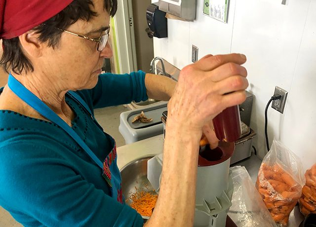 Judy Harder works in the Peacemeals kitchen, making jam and bread between lunch orders.
