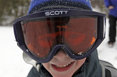 kid in ski goggles