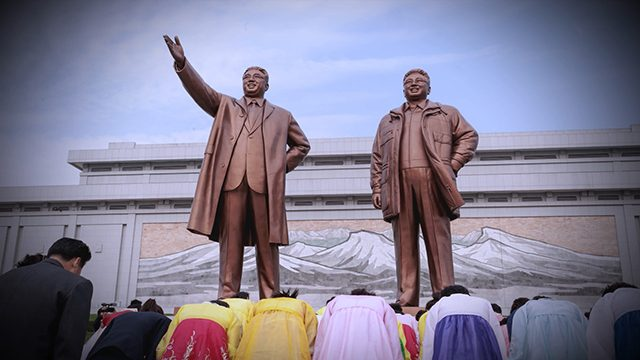 """Statues of Kim Il Sung and his son and successor, Kim Jong Il, from """"The Dictator's Playbook."""""""