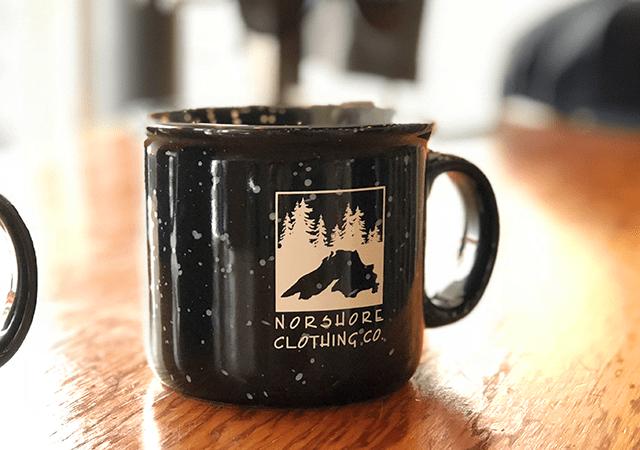 A NorShore Clothing Co. coffee mug.