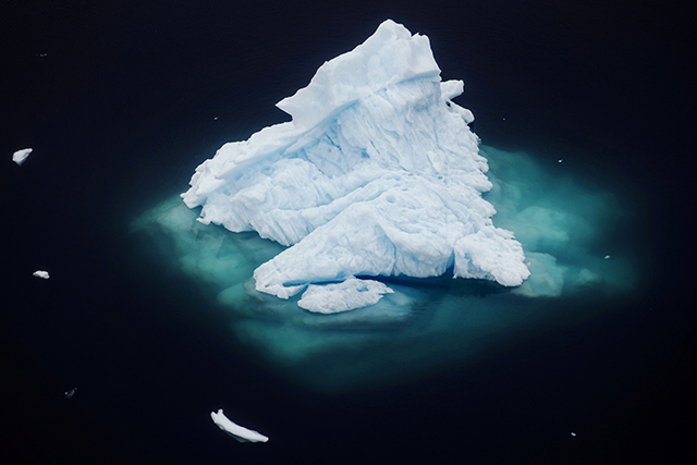 photo of an iceberg in the sea