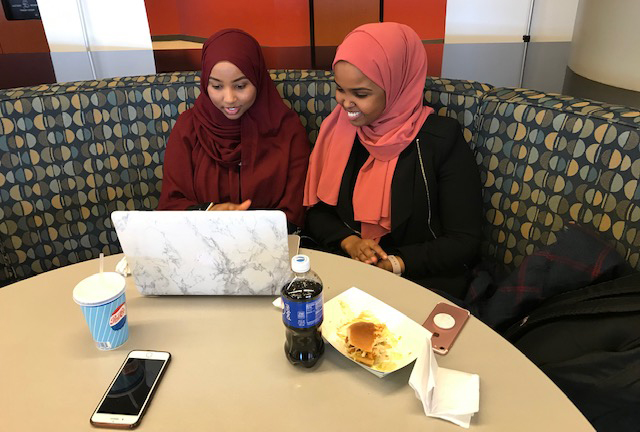 Students study over lunch at Saint Paul College.