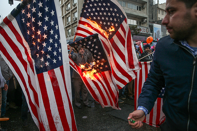 Iranians burn U.S. flags during a ceremony