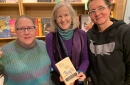 photo of three women holding abook