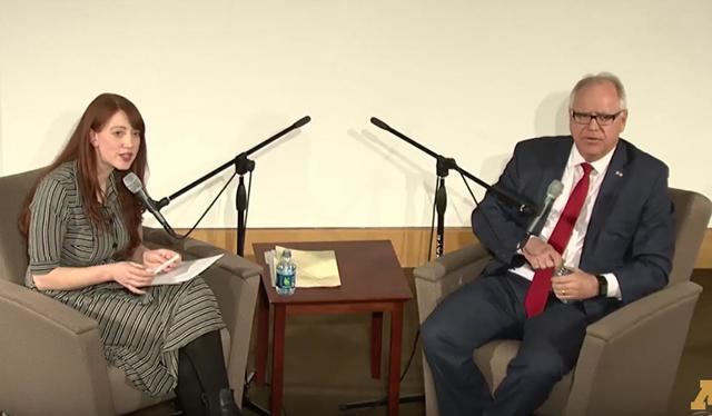 photo of briana bierschbach and gov. tim walz speaking on stage