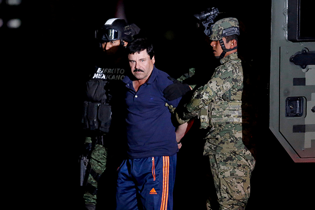 "photo of joaquin ""el chapo"" guzman being escorted by soldiers"