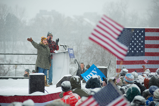 photo of lt. governor peggy flanagan waving to crowd amid snow