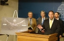 photo of people speaking at lectern