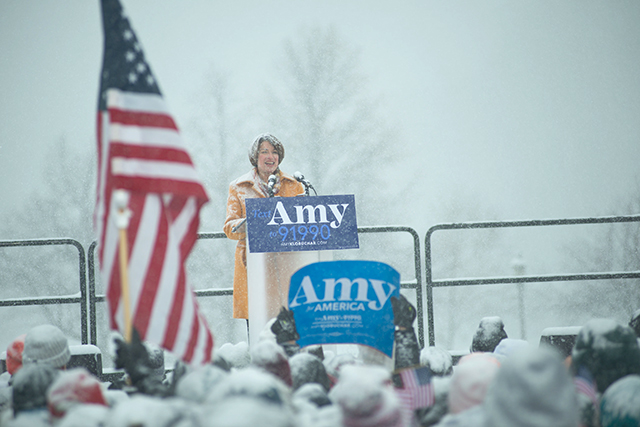 photo of amy klobuchar speaking from lectern to crowd