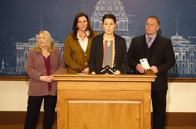 photo of four legislators at press conference