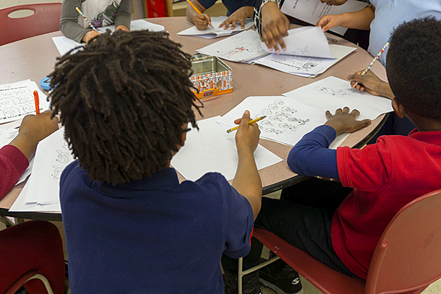 Arts Us students practice drawing cartoon characters on a Wednesday afternoon.