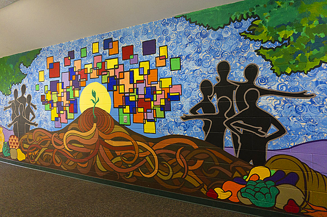 A hallway mural painted by middle schoolers who participated in the Arts Us healthy eating summer program.