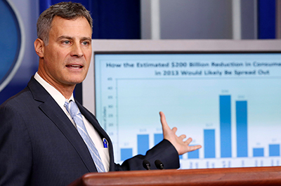photo of alan krueger speaking at lectern