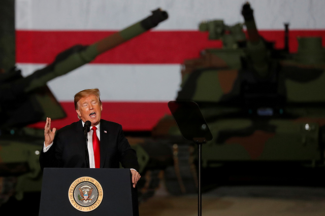 photo of donald trump speaking at tank factory