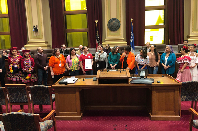 photo of people standing in council chamber