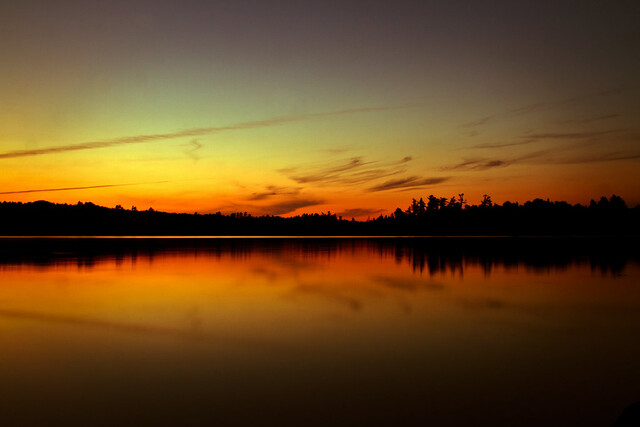 photo of sunset over lake in boundary waters